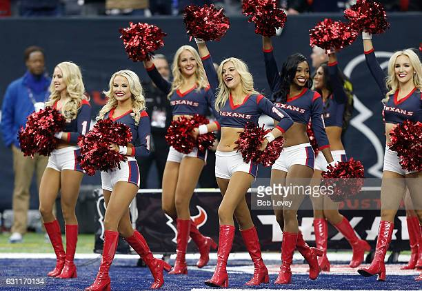 The Houston Texans cheerleaders perform on the field during the AFC Wild Card game against the Oakland Raiders at NRG Stadium on January 7 2017 in...
