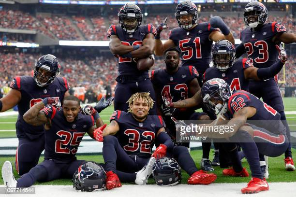 The Houston Texans defense celebrates after an interception in the second quarter against the Cleveland Browns at NRG Stadium on December 2 2018 in...
