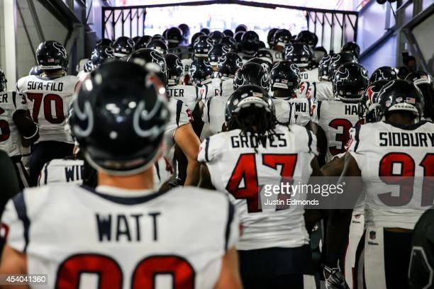 The Houston Texans including JJ Watt stand in the tunnel before running out to play against the Denver Broncos during a preseason game at Sports...
