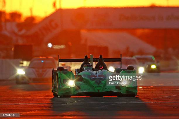 The HPD-ARX 03B of Scott Sharp, Ryan Dalziel and David Brabham is shown in action at sunset during the 12 Hours of Sebring at Sebring International...