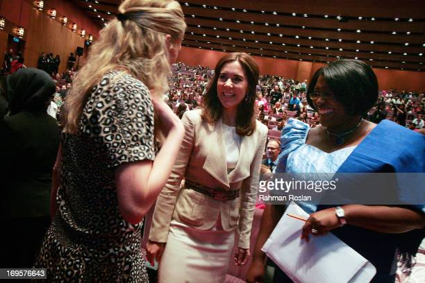 The HRH Crown Princess Mary of Denmark chats with Princess Mabel of OrangeNassau and The First Lady of Zambia Christine Kaseba during The Women...