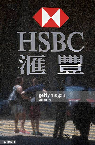 The HSBC Holdings Plc logo is displayed outside a branch in Hong Kong China on Sunday July 31 2011 HSBC Europe's largest bank by market value agreed...