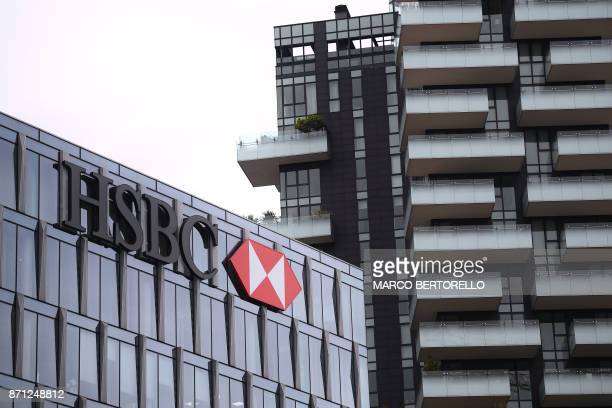 The HSBC logo is displayed on the facade of the HSBC headquarters in Milan on November 7 2017 / AFP PHOTO / MARCO BERTORELLO