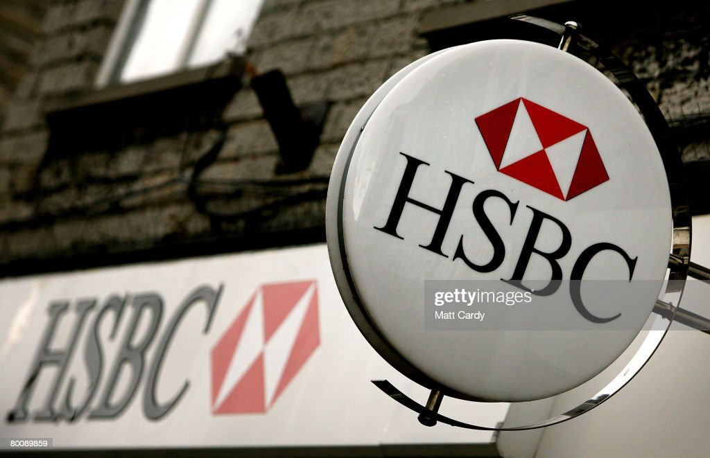 The HSBC logo is displayed outside a branch of HSBC on March 3 2008 in Street, United Kingdom. HSBC, the UK's largest bank, has said it has made a 8.7bn GBP loss, after the decline in the US housing market hit the value of its loans. The bank's losses are said to be the biggest write-down of the UK's big five because it has a lot of business and operations in the USA, however its annual profits still rose 10 percent to 12.2bn GBP, up from the year before.
