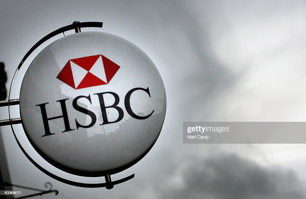 The HSBC logo is displayed outside a branch of HSBC on March 3, 2008 in Street, United Kingdom. HSBC, the UK's largest bank, has said it has made a 8.7bn GBP loss, after the decline in the US housing market hit the value of its loans. The bank's losses are said to be the biggest write-down of the UK's big five because it has a lot of business and operations in the USA, however its annual profits still rose 10 percent to 12.2bn GBP, up from the year before.