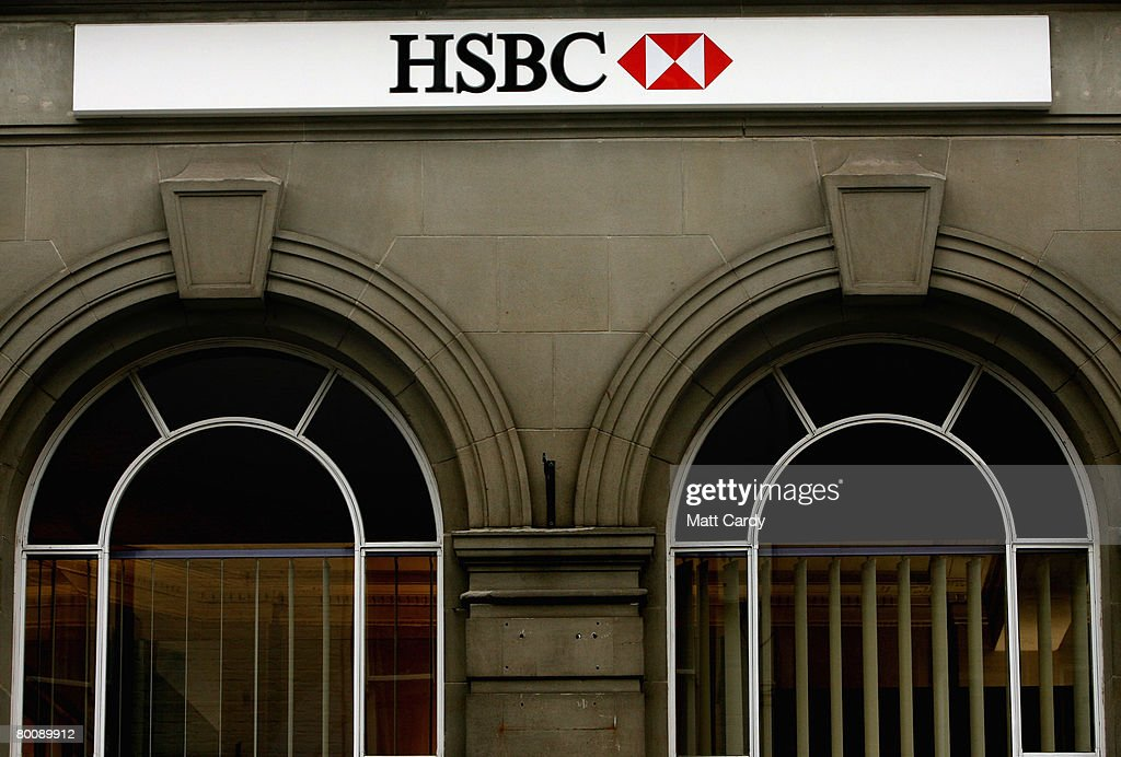 The HSBC logo is displayed outside a branch of HSBC on March 3 2008 in Wells, United Kingdom. HSBC, the UK's largest bank, has said it has made a 8.7bn GBP loss, after the decline in the US housing market hit the value of its loans. The bank's losses are said to be the biggest write-down of the UK's big five because it has a lot of business and operations in the USA, however its annual profits still rose 10 percent to 12.2bn GBP, up from the year before.