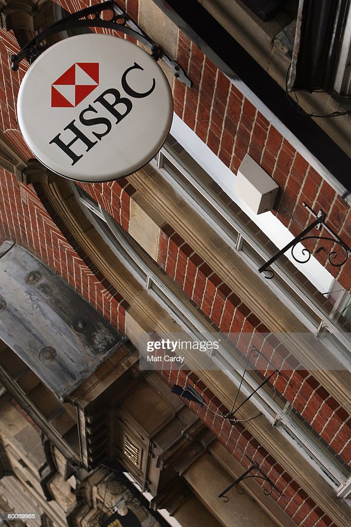 The HSBC logo is displayed outside a branch of HSBC on March 3 2008 in Glastonbury, United Kingdom. HSBC, the UK's largest bank, has said it has made a 8.7bn GBP loss, after the decline in the US housing market hit the value of its loans. The bank's losses are said to be the biggest write-down of the UK's big five because it has a lot of business and operations in the USA, however its annual profits still rose 10 percent to 12.2bn GBP, up from the year before.
