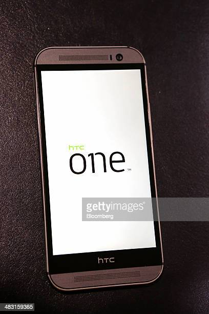 The HTC Corp One M8 smartphone is displayed for a photograph at one of the company's stores in Taipei Taiwan on Saturday April 5 2014 HTC last month...