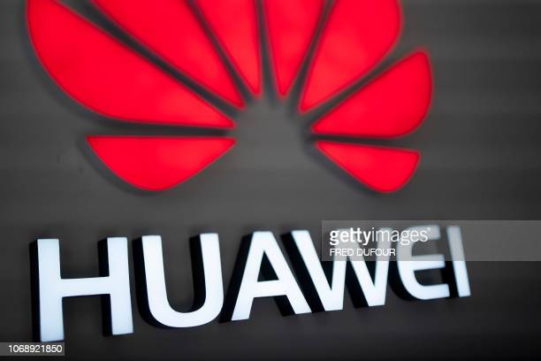The Huawei logo is displayed at a store in Beijing on December 6 2018 The chief financial officer of China's global telecommunications giant Huawei...