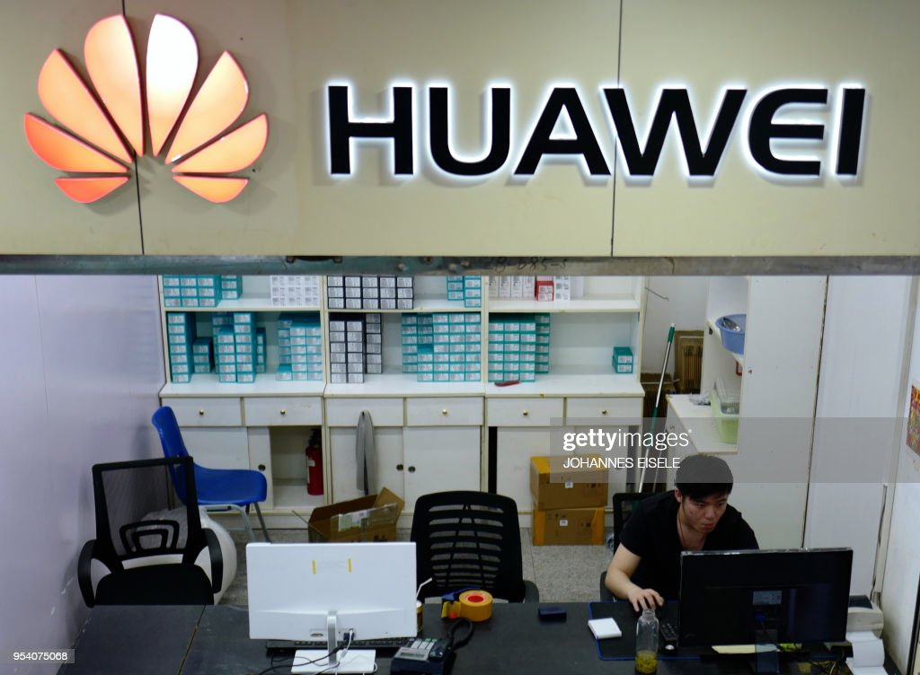 The Huawei logo is seen in a shop in Shanghai on May 3, 2018