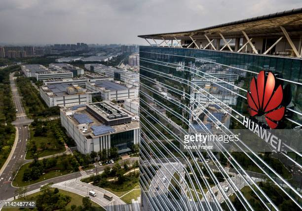 The Huawei logo is seen on the side of the main building at the company's production campus on April 25 2019 in Dongguan near Shenzhen China Huawei...
