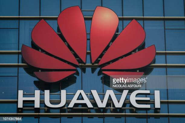 The Huawei logo stands on a Huawei office building in Dongguan in Chinas southern Guangdong province on December 18 2018