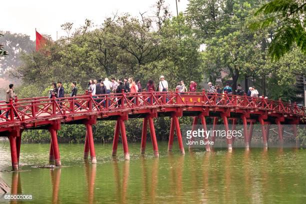 The Huc is a red painted bridge that crosses Hoan Kim Lake in central Hanoi