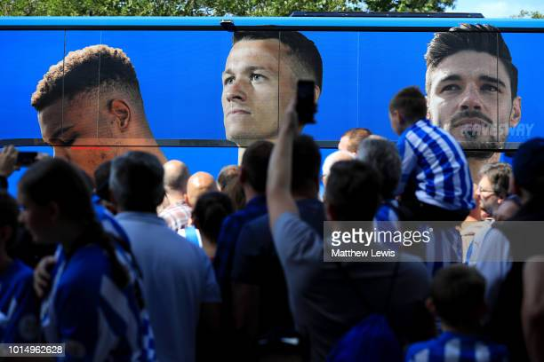 The Huddersfield Town team bus arrives at the stadium prior to the Premier League match between Huddersfield Town and Chelsea FC at John Smith's...
