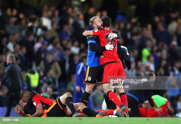 The Huddersfield Town team celebart avoiding relegation after the Premier League match between Chelsea and Huddersfield Town at Stamford Bridge on...