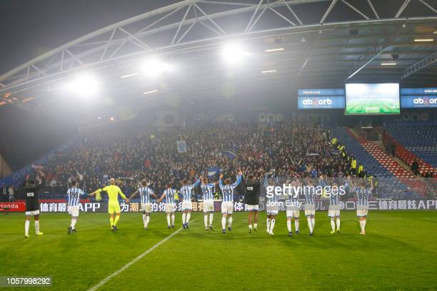 The Huddersfield Town team celebrate in front of their fans after the Premier League match between Huddersfield Town and Fulham FC at John Smith's...