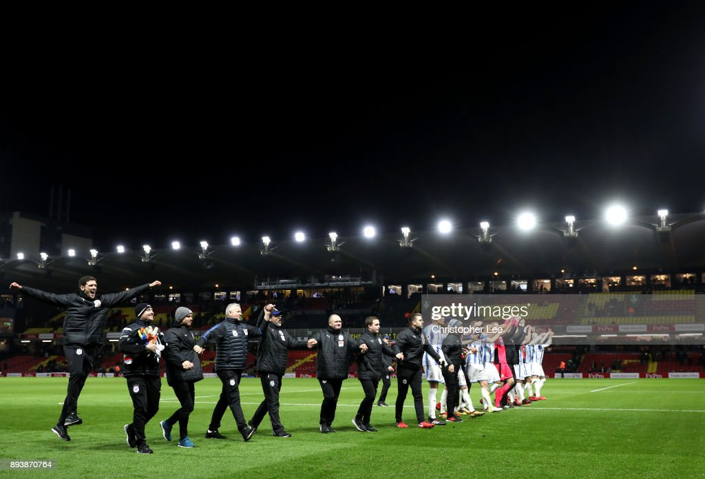 The Huddersfield Town team celebrate victory after the Premier League match between Watford and Huddersfield Town at Vicarage Road on December 16, 2017 in Watford, England.