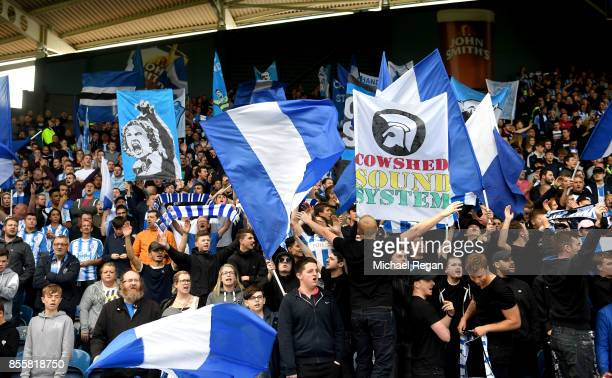 The Huddersfield Town Ultras surport their team prior to the Premier League match between Huddersfield Town and Tottenham Hotspur at John Smith's...