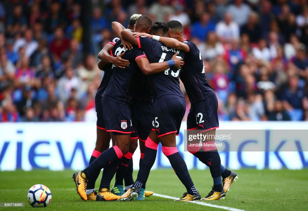 The Huddersield Town team celebrate their first goal of the game during the Premier League match between Crystal Palace and Huddersfield Town at Selhurst Park on August 12, 2017 in London, England.