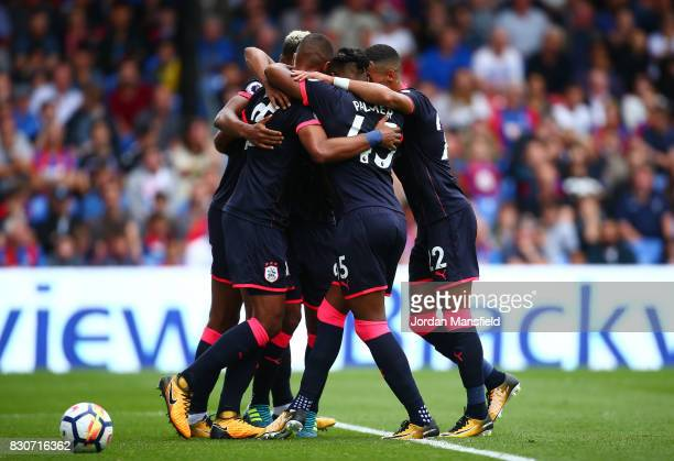 The Huddersield Town team celebrate their first goal of the game during the Premier League match between Crystal Palace and Huddersfield Town at...