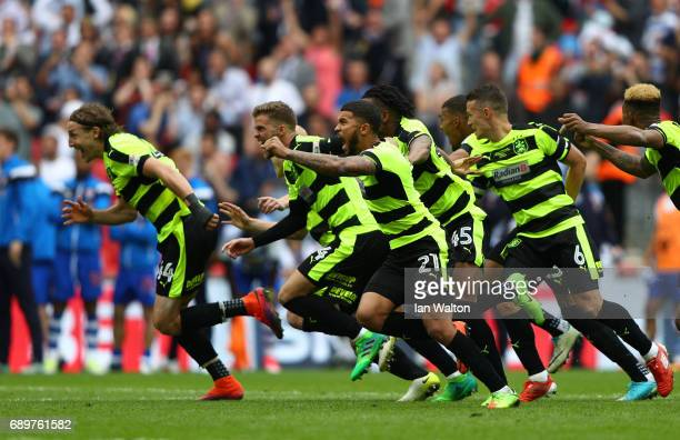 The Huddersield Town team celebrates promotion to the Premier League after winning a penalty shoot out after the Sky Bet Championship play off final...