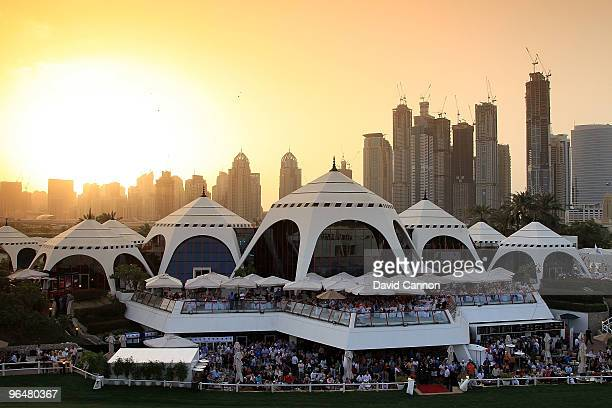 The huge crowds watch the big screen of the play-off from the clubhouse as the sun sets after the final round of the 2010 Omega Dubai Desert Classic...