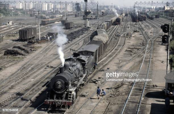The huge marshalling and dump yard at Harbin is overhauled by Sankong Bridge known in the 1980s as the greatest trainwatching place in the world...