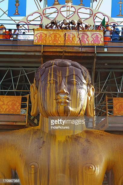 The huge monolithic statue of Lord Gomateshwara bathed in a paste of turmeric powder during the Mahamastakabhisheka Festival at Shravanabelagola...