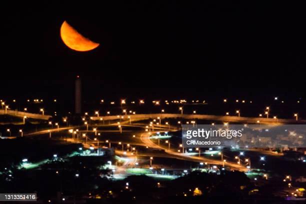 the huge moon with all its splendor on deserted streets and orange color lighting. - crmacedonio bildbanksfoton och bilder