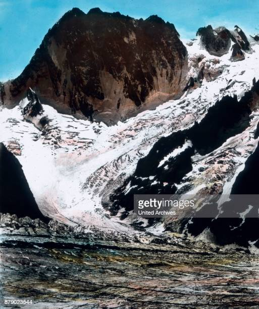 The huge rock walls of the dangerous Grandes Jorasses piled up to the right of the Mont Mallet glacier steeply falls down while on the left the...
