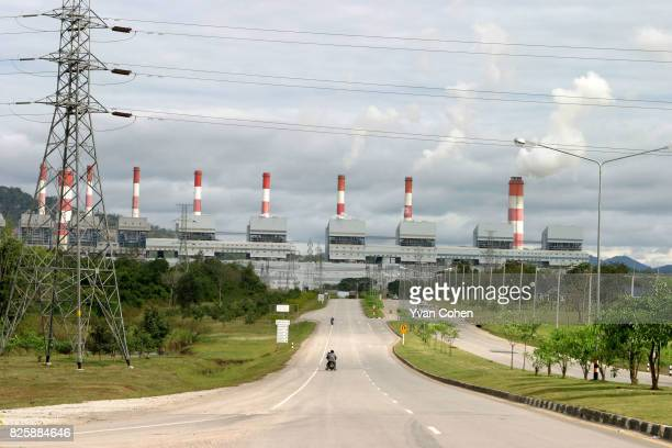 The huge smoke stacks of the Mae Moh power plant, dominate the horizon. Mae Moh district in northern Thailand's Lampang province is home to Southeast...