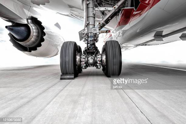 the huge wheels of the plane were parked on the runway of the airport - wheel stock pictures, royalty-free photos & images