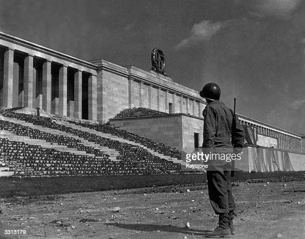 The huge Zeppelin Stadium at Nuremberg built to display Nazi might is in Allied hands Here the Nazi Party held its rallies and Hitler made his...