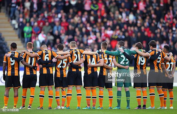 The Hull City players take part in a minutes silence in honour of Remembrance Day prior to the Premier League match between Hull City and Southampton...