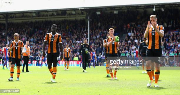 The Hull City players walk off the pitch looking dejected after being relegated to the Championship after the Premier League match between Crystal...