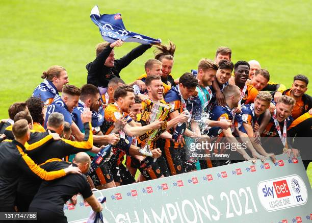 The Hull City squad celebrate with the Sky Bet League One trophy following the Sky Bet League One match between Charlton Athletic and Hull City at...