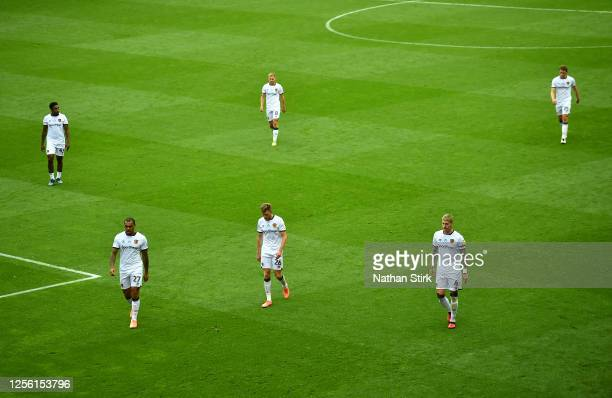 The Hull City team walk off dejected at half time during the Sky Bet Championship match between Wigan Athletic and Hull City at DW Stadium on July...