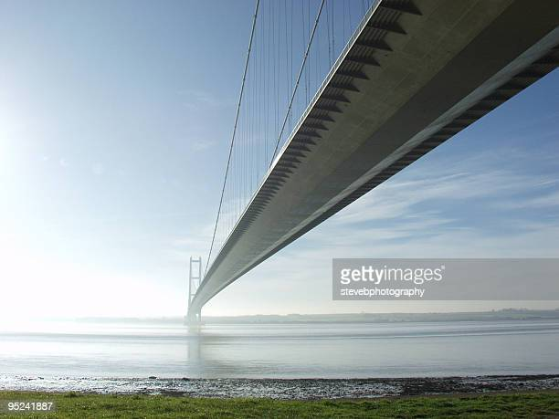 the humber bridge spanning across the water - suspension bridge stock photos and pictures