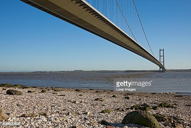 The Humber Bridge which is a single span suspension bridge connecting East Yorkshire with North Lincolnshire near to Hull Hull England