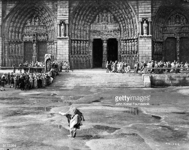 The hunchback Quasimodo played by Charles Laughton makes his way to the cathedral in a scene from 'The Hunchback of Notre Dame' directed by William...