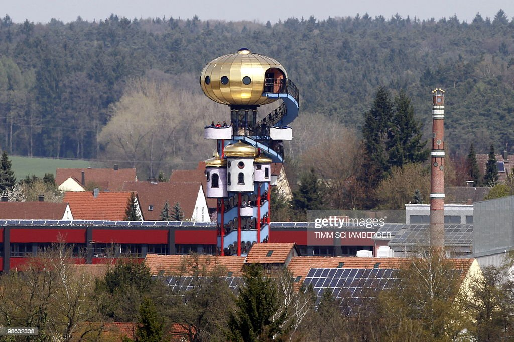 The Hundertwasser Tower, built by Austrian architect Friedensreich Hundertwasser (born as Friedrich Stowasser) is pictured in Abensberg, southern Germany on April 23, 2010. After rejection of the original design by the protection of historical buildings and monuments, a smaller version by Austrian architect Peter Pelikan was built.