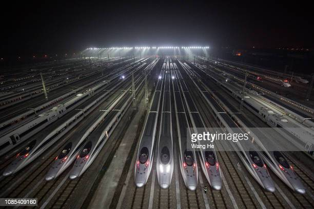 The Hundreds of highspeed trains at a maintenance base wait to set out on January 20 2018 in Wuhan Hubei province China The peak of Spring Festival...