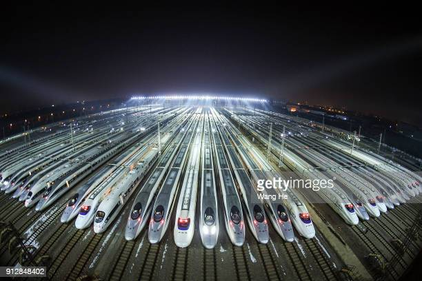The Hundreds of highspeed trains at a maintenance base wait to set out on the first day of the 40day Spring Festival Travel Peak on February 1 2018...