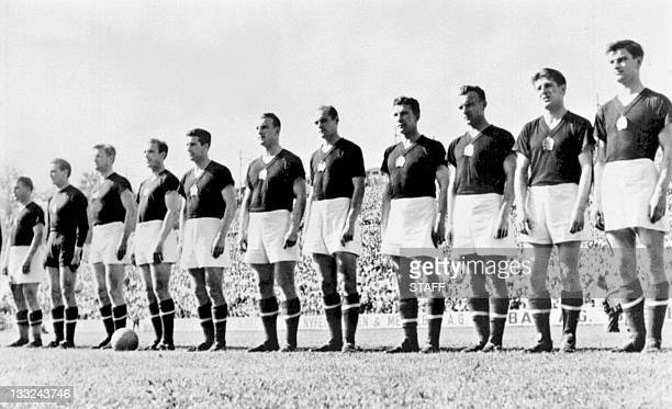 The Hungarian national soccer team is lined up during the national anthem before its World Cup first round soccer match against West Germany 20 June...