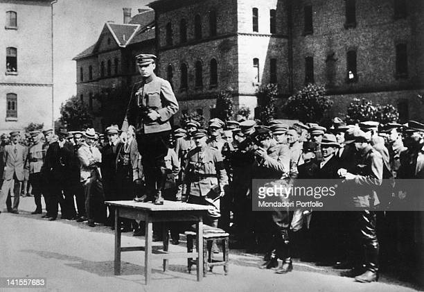 The Hungarian people's commissar Bela Szanto standing on a table speaking to the revolutionary soldiers before attacking the counterrevolutionaries...