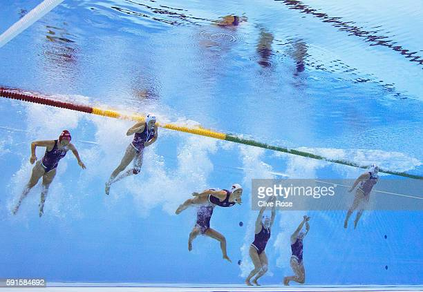 The Hungarian women's national team jump in to start their Women's Semi Final match against USA at Olympic Aquatics Stadium on August 17 2016 in Rio...