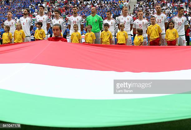The Hungary team line up for the national anthem behind their counmtries flag during the UEFA EURO 2016 Group F match between Iceland and Hungary at...