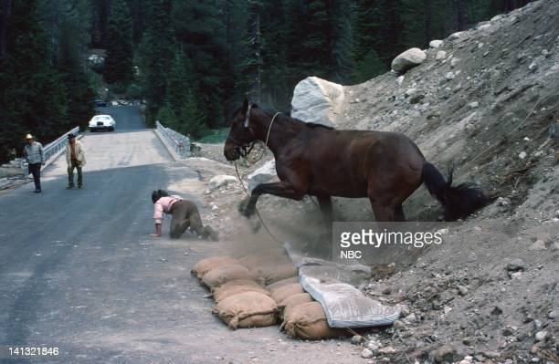 PRAIRIE 'The Hunters' Episode 10 Pictured Stunt coordinator and Michael Landon stand in Hal Burton performs a stunt with a horse Photo by NBCU Photo...
