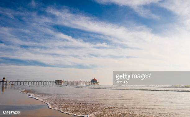 the huntington beach pier on a beautiful day - huntington beach stock pictures, royalty-free photos & images