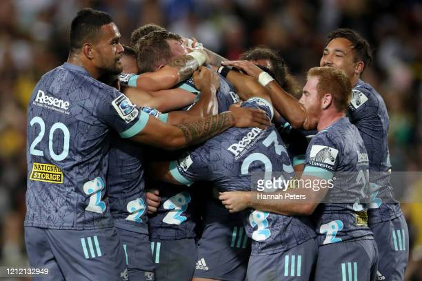 The Hurricanes celebrate after winning the round seven Super Rugby match between the Chiefs and the Hurricanes at Waikato Stadium on March 13 2020 in...